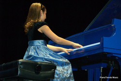 Miss Emily Bear at the Raue Center in her concert with Danny Wright on the twin Blue Grand Pianos