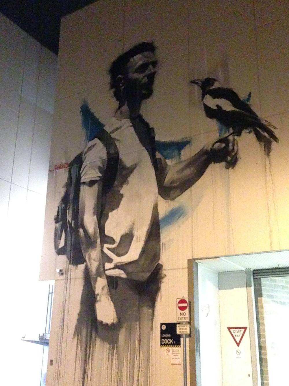 street art man with bird
