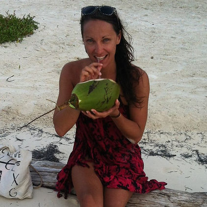 Me sipping a coconut