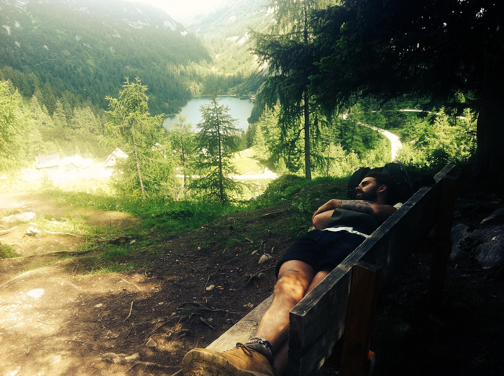 person lying on bench