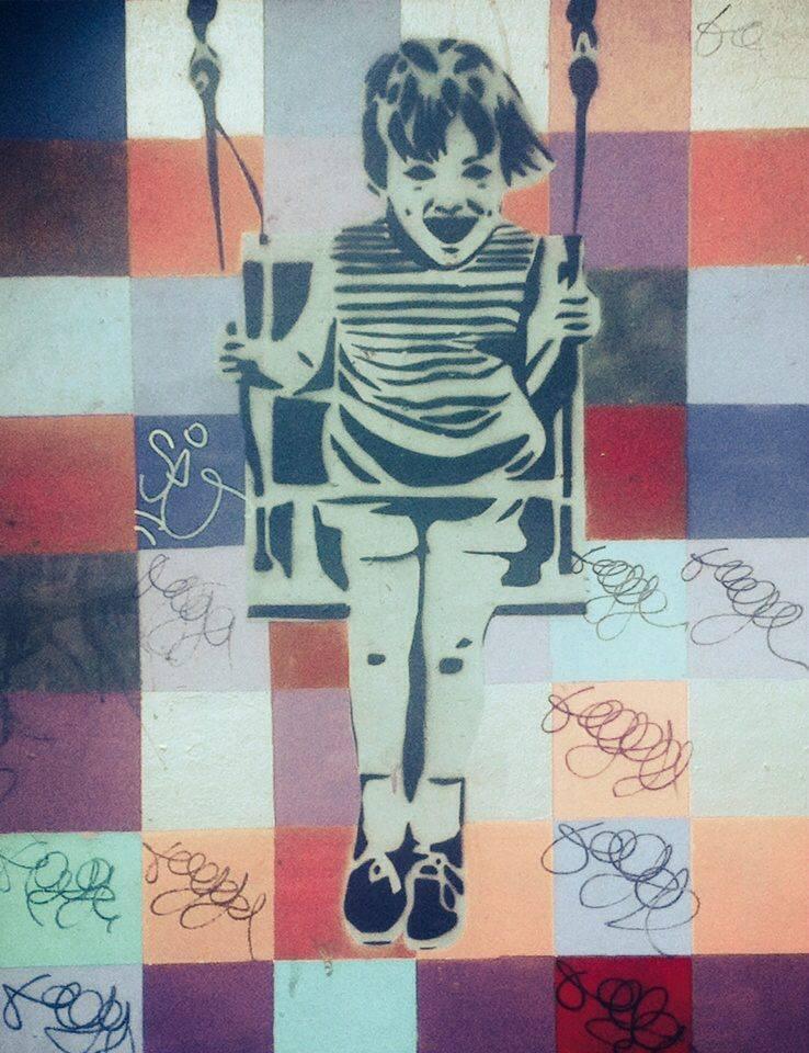 street art kid on a swing