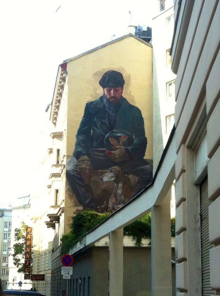 street art man with dog and goldfish