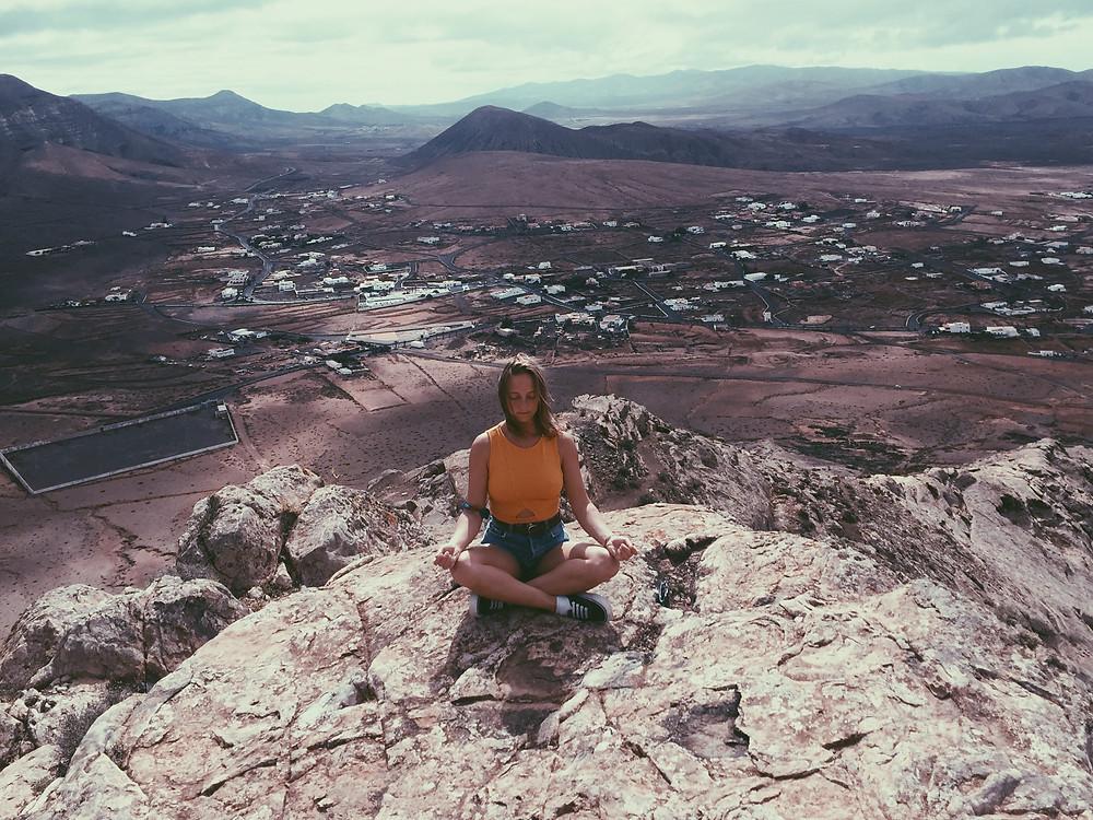 meditating on mountain