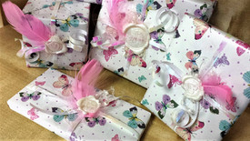 Gift wrapping with wax seals and feather