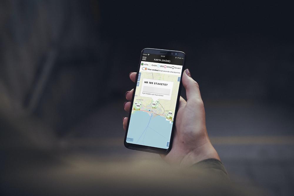 Skärmavbild från Hitta ut appen i en Iphone-mockup
