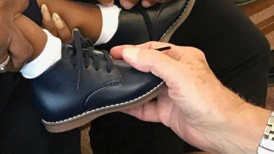 C-Ped Fitting a kids shoe