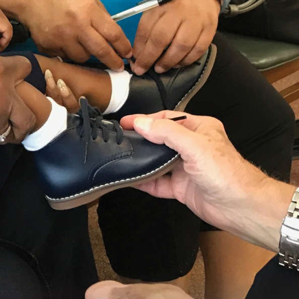 C-Ped Fitting a kids shoe