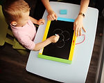 boy drawing chalk board
