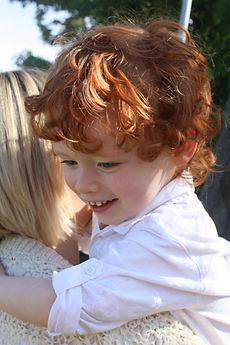 autism boy hugs