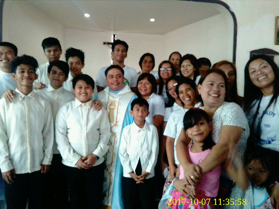 Fr. Rey and the officers