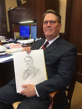 Wright Pinson, CEO of Vanderbilt Health System, with his portrait sketch, drawn from life by Igor Babailov, in Nashville, TN