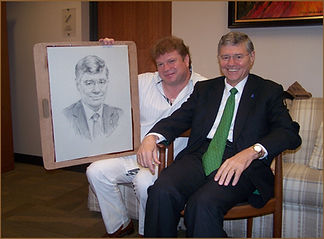 Igor Babailov with Tom Monaghan, founder of Domino's Pizza.