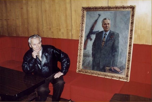 AK-47 inventor Mikhail Kalashnikov with his portrait by portrait artist Igor Babailov, at the Central Armed Forces Museum of Russia.