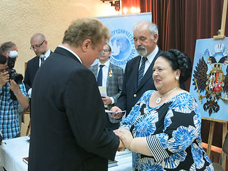 Her Imperial Highness Grand Duchess Maria Vladimirovna presenting Igor Babailov with the Order of St. Anne, in Malta