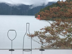 View of Hakone Shrine from the shores of Lake Ashi