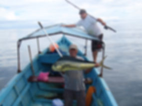 Jason gamble and don pedro cruz show off mahi mahi during a fishing tour outside on tamarindo costa rica
