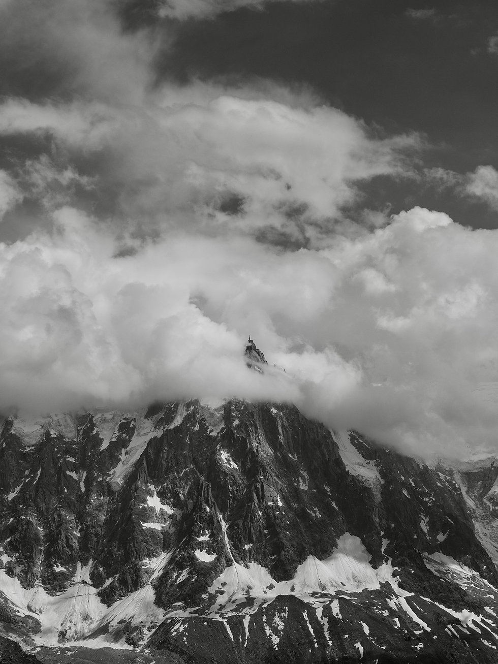 The Aiguille du Midi crossing the summer clouds