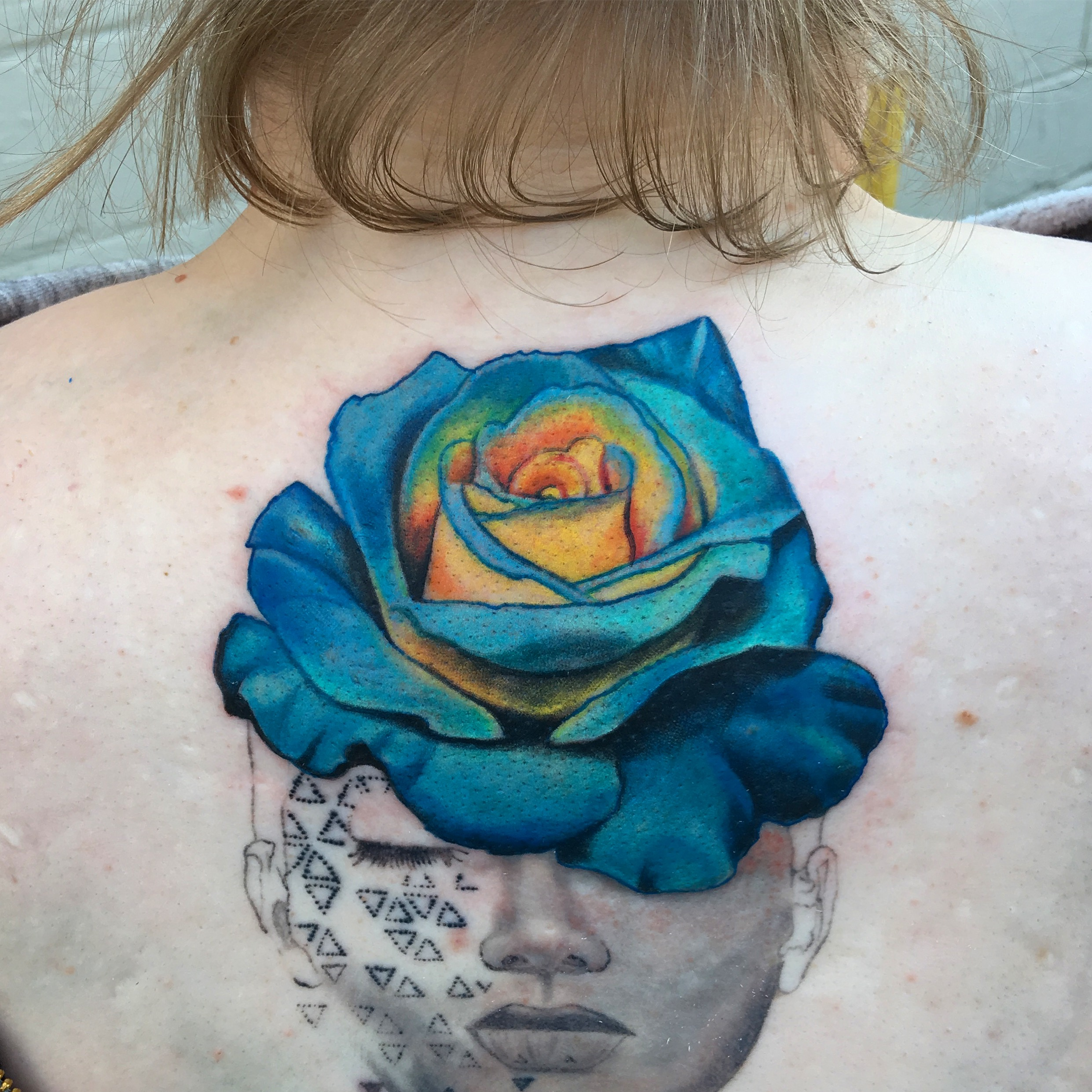 geogirl rose head tattoo