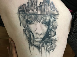 realism watercolor tattoo