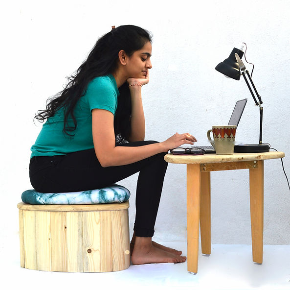 E low stool and working table with cushi