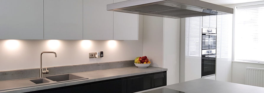White gloss handle less kitchen