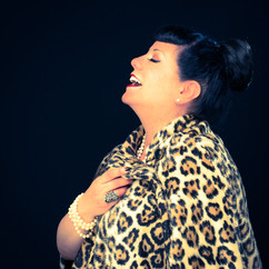commercial-branding-portrait-photography-lifestyle-writer-inspiration-leopard-fur-cape.jpg