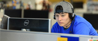 commercial-photography-candid-office-person-monitor-hat-headset-closeup.jpg