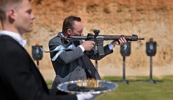 commercial-branding-photography-expo-tradeshow-booth-banner-csuite-shooting-gun-range-practice-range.jpg