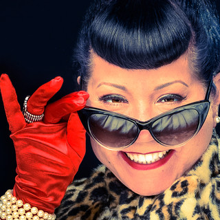 commercial-branding-photography-portrait-writer-inspiration-lepard-fur-cape-sun-glasses-smiling-peeking-red-gloves-closeup.jpg