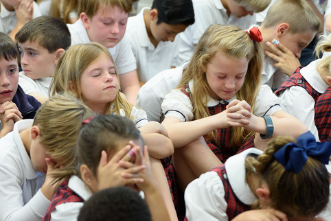 branding-photography-assembly-closeup-private-school-praying-kids-children-uniform-plaid.jpg
