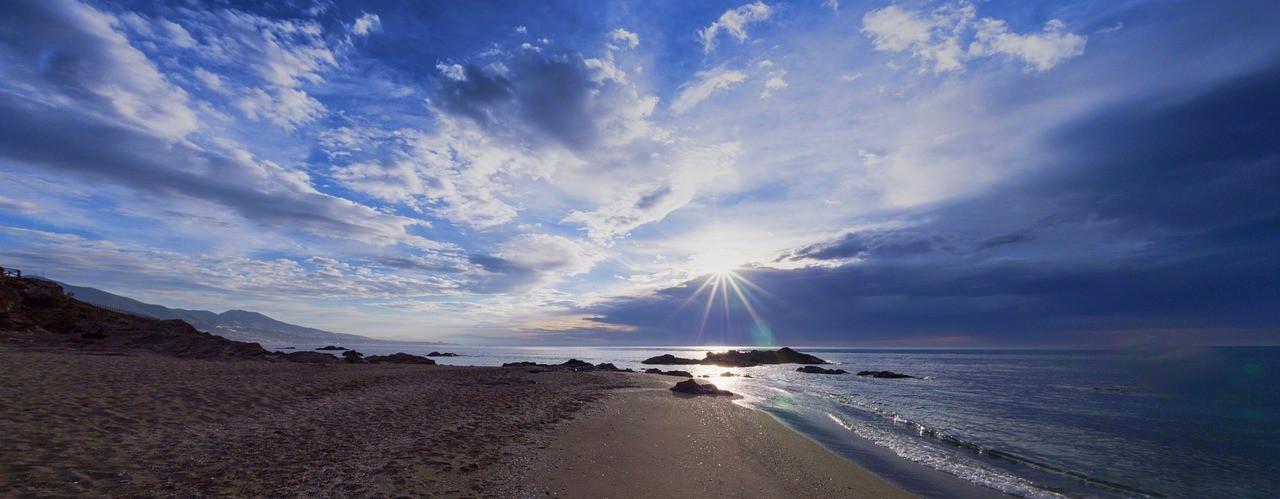 andalusia-costa-del-sol-beach-clouds.jpg