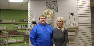 Father and daughter, Forrest and Kristin Frymoyer, stand in the company's Bettendorf office, which features many examples of products and materials available to residential and commercial customers.