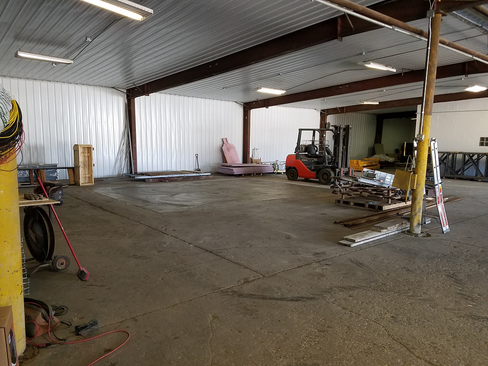 The tin installed in the front warehouse and the floor is clean again!  Moving on to the next to do on the renovation list.