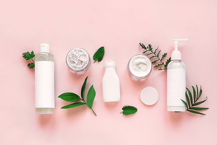 Natural cosmetics and green leaves on pi