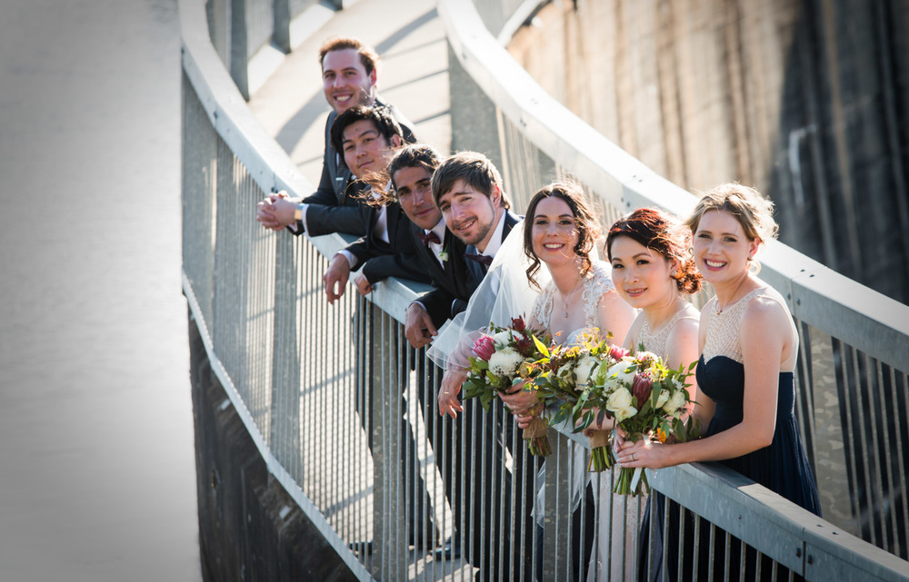 bridal party on bridge
