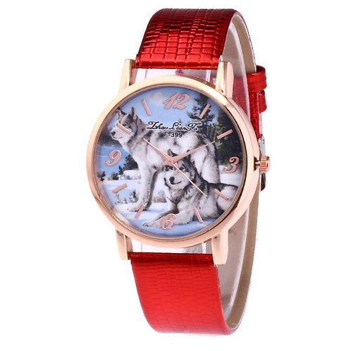 Horloge met wolven op de sneeuw