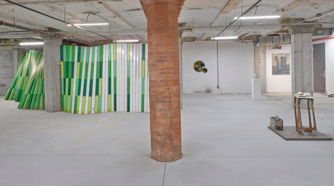 """left to right  Cordy Ryman """"Green Wave""""  Acrylic and enamel on wood 373 x 36 x 98 inches (overall dimensions vary)   2007-2019  Damien Davis """"The Abandoned (Blackamoors Collage #149)"""" CNC routed Baltic birch, plexiglass, mirror and stainless steel hardware  26 x 29 inches 2018  Erik Doty """"Kudzu 1"""" Toned cyanotype print  46 x 37 inches 2019  Matthew Whitenack  """"Short Term Arrangement""""  mixed media 48 x 48 x 48 inches 2019"""