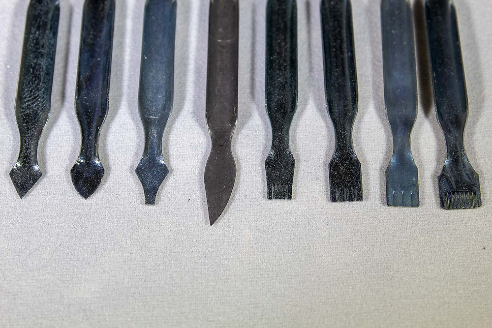 Example of a wide variety of tools that can be used for scratchboard etching.