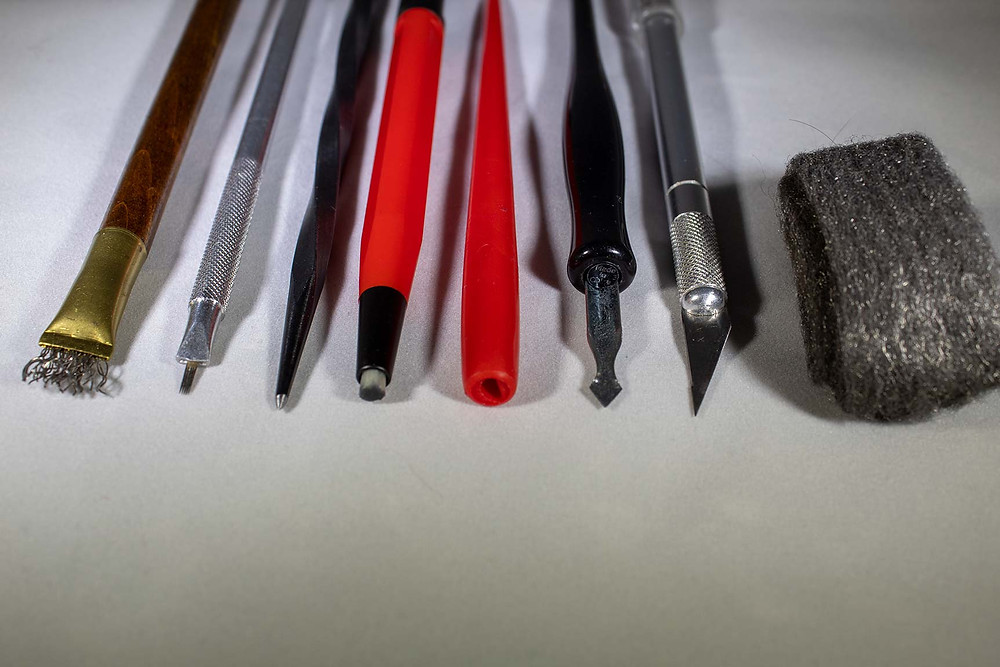Variety of Scratchboard Etching tools including steel wool, X-acto knife, parallel lines tool, and more.