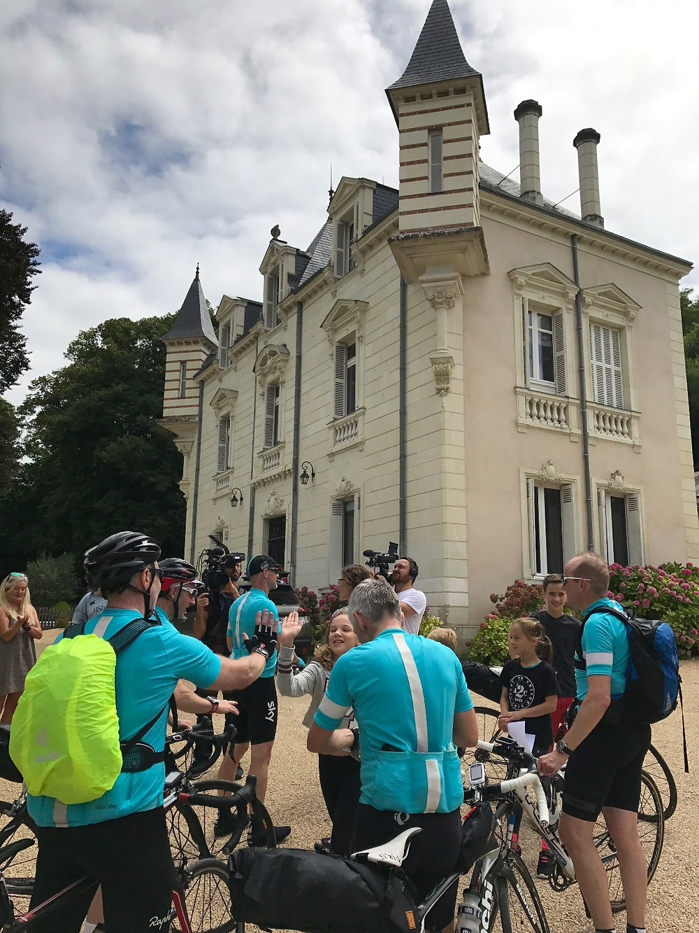 Cycling team arrive at Chateau La Perriere