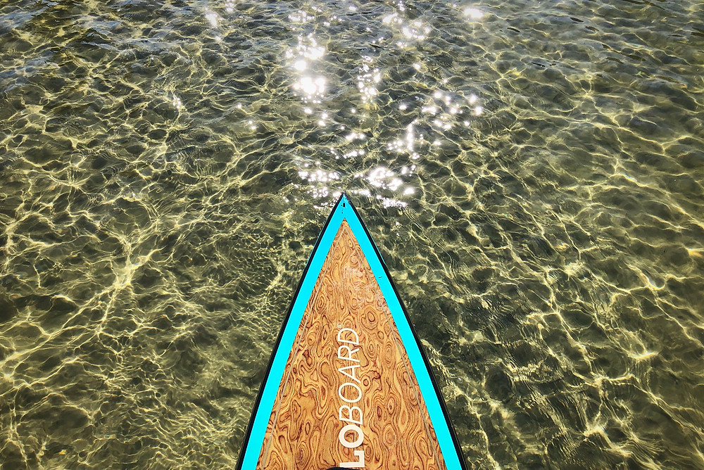 paddle board over beautiful clear water