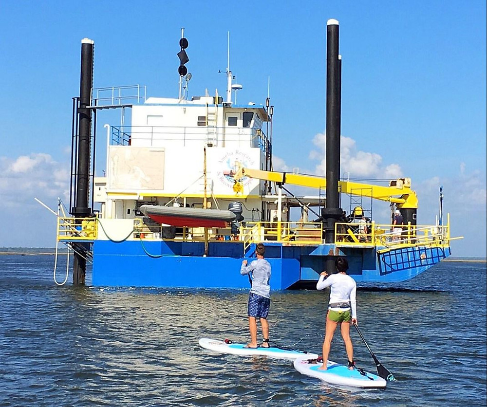 hunting for treasure on paddle boarding tour