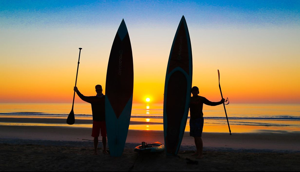 paddle boarding at sunrise