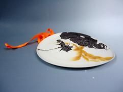 orange- homme -faux plat1 sur lit - alex