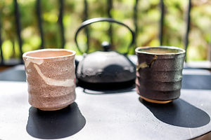 Cast iron teapot on table outside by fen