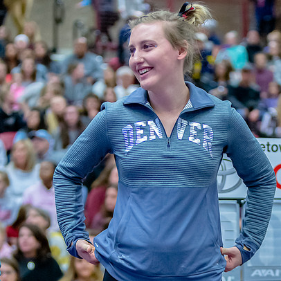 Grace Broadhurst during rotation from vault to uneven bars