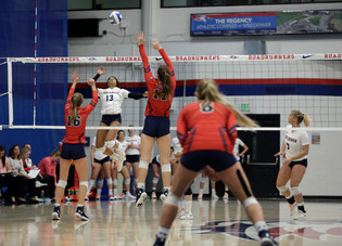 MSU Kyla White (#13) dinks ball over heads of CSU blockers Brooke Schilling (#16) and Berkley Hays (#17)