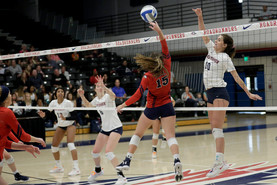 MSU Taylor Duryea (#10 spikes ball past CSU Grace Hern (#15)
