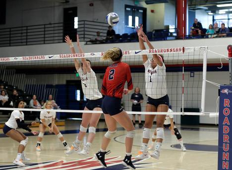 MSU Santaisha Sturges (#1) blocks ball back to CSU Maddy Wisniewski (2) while MSU teammate Alyssa Kelling (#8) watches