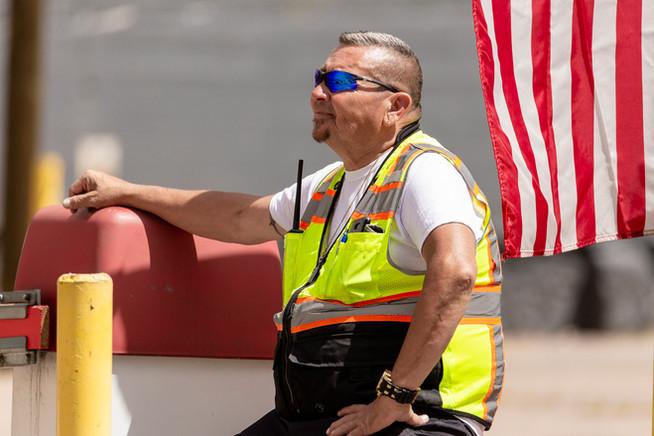 Parking attendant watching Cinco de Mayo Parade, Denver, Colo., 2019